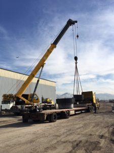 Crane loading Step Deck